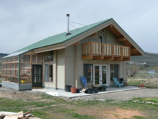 The Maechtlen cottage is made from recycled pallets re-made into a Insulated Concrete Form to give this house high thermal mass. This is a solar passive house with a green house attached.